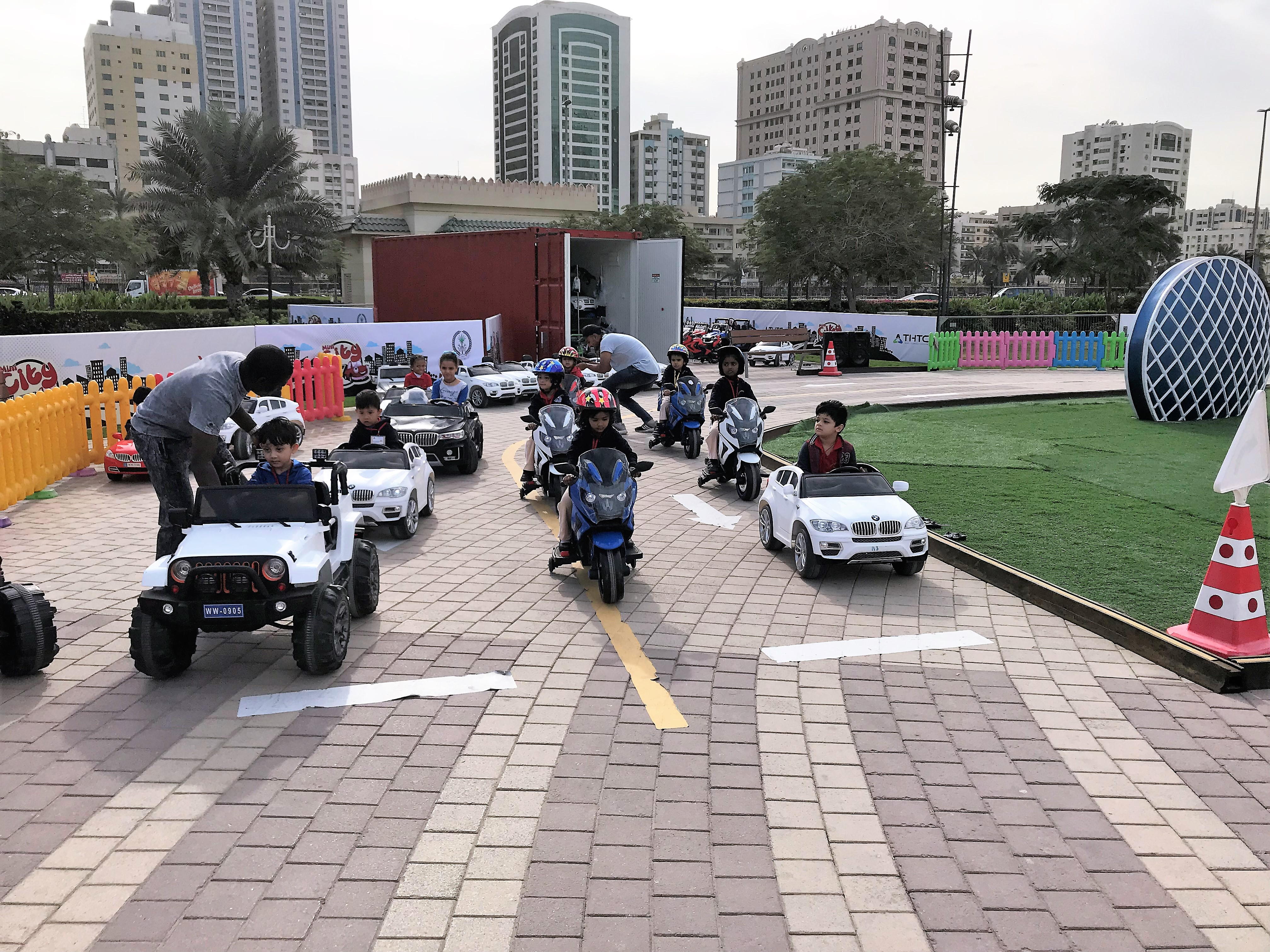 children learn road safety skills while having fun at al majaz waterfront