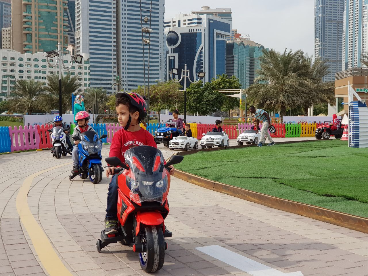 children learn road safety skills while having fun at al majaz waterfront2