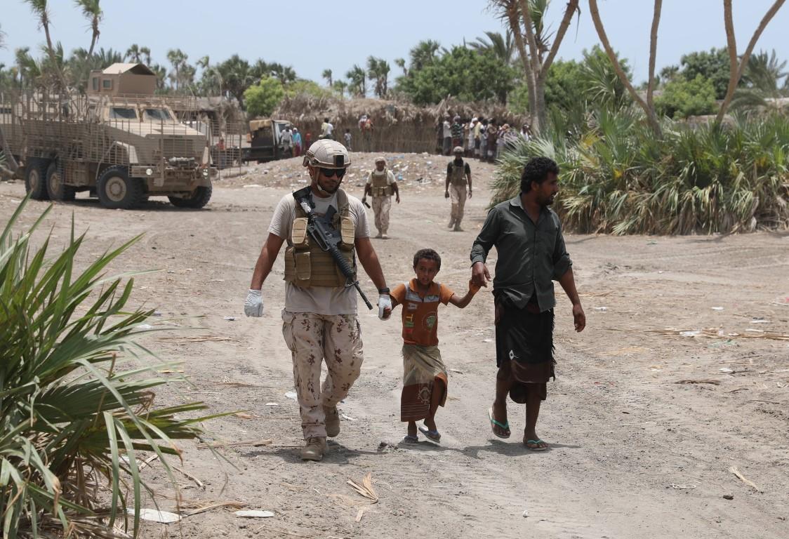 UAE soldier with Yemeni locals - Gulaifica /Medium/