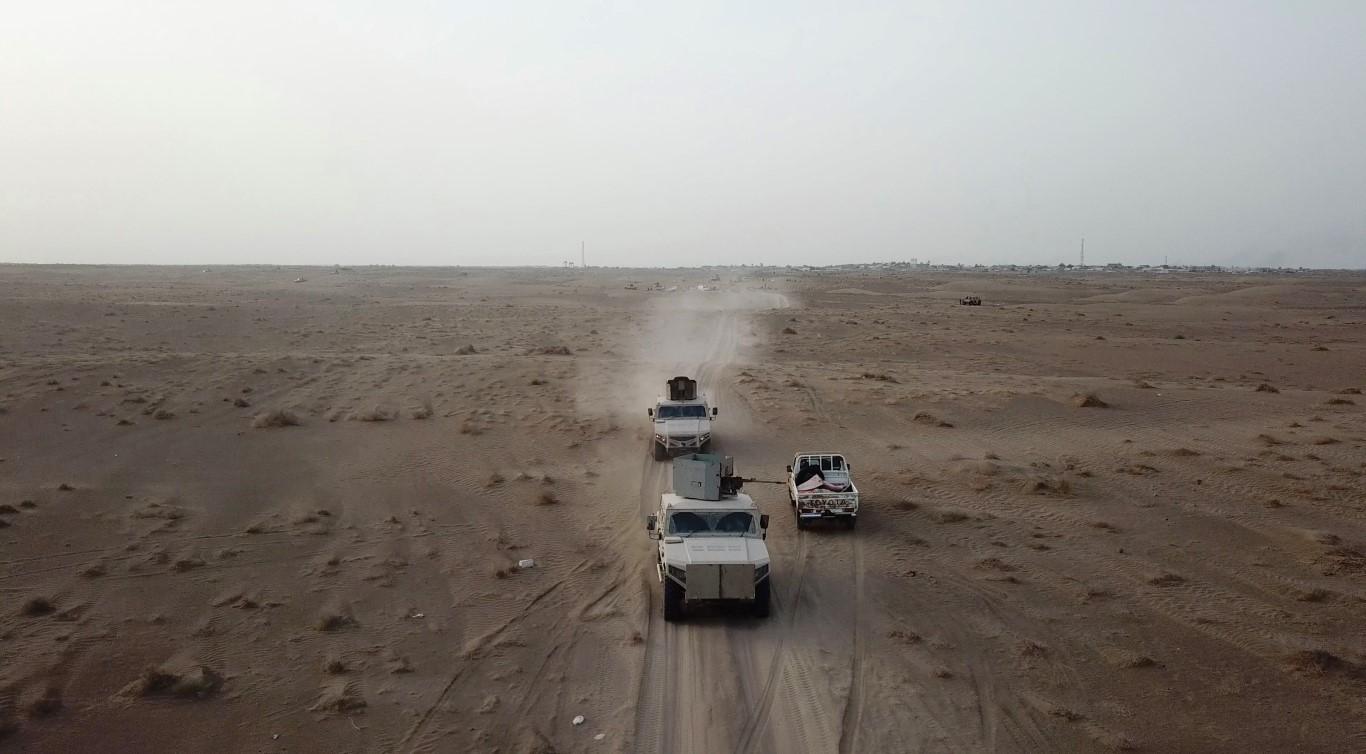 Vehicles move through the battle ground - Al Durayhami /Medium/