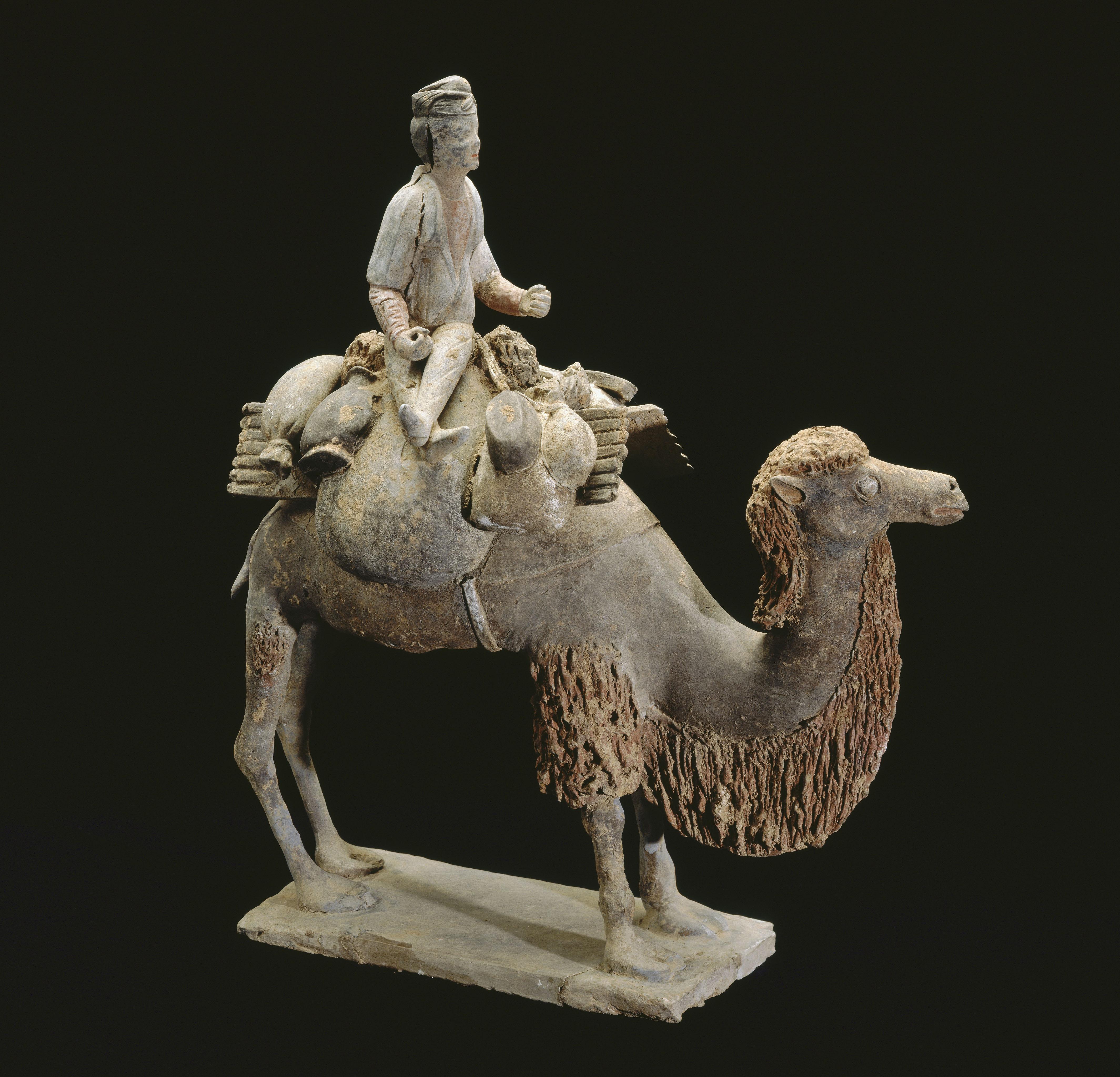 funerary figure (mingqi), caravanner on a camel © rmn-grand palais (mnaag, paris)  thierry ollivier